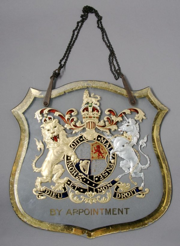 An English Gilt and Silvered Glass Sign, Height 12 3/4