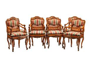 A Set of Eight Louis XV Style Carved Walnut Dining