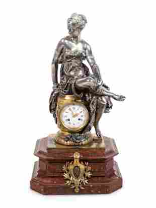 A Napoleon III Gilt and Silvered Bronze and Rouge