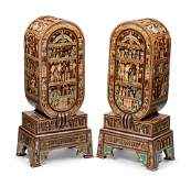 A Pair of Egyptian Style Painted and Inlaid Cabinets