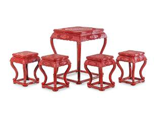 A Chinese Export Carved Red Lacquer Game Table and Four
