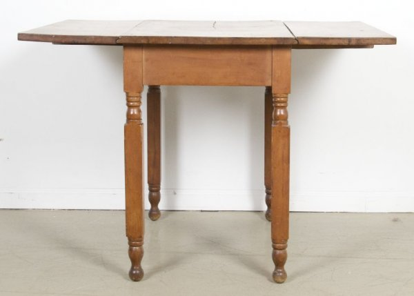 10: An American Pine Drop-Leaf Table, Height 28 x width