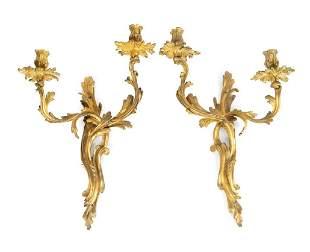 Four Louis XV Style Gilt-Bronze Two Light Sconces