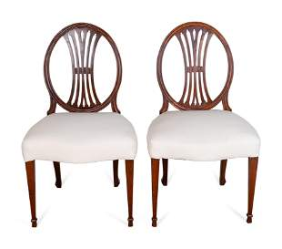 A Set of Six George III Carved Mahogany Dining Chairs