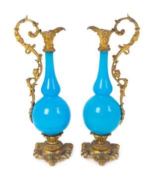A Pair of Gilt Bronze Mounted Blue Opaline Glass Ewers