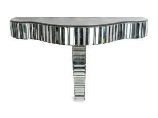 A Contemporary Mirrored Glass Serpentine Console
