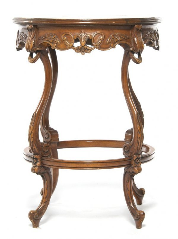 A Louis XVI Style Marquetry Center Table, Height 27 1/2