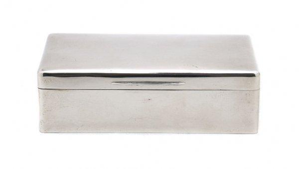555: An English Silver Cigarette Box, Width 6 3/4 inche