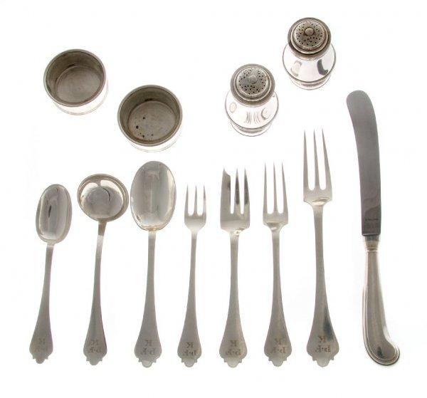 557: An English Silver Flatware Service for Twelve, Len