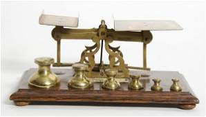 An English Brass Postal Scale, Length 9 1/2 inches.