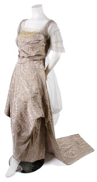 7: A French Couture Champagne Brocade Evening Gown,