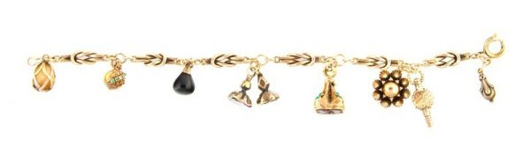 A Yellow Gold Charm Bracelet, 14.73 dwts.