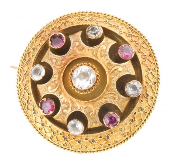 A Gilded Silver and Rhinestone Brooch, 7.77 dwts.