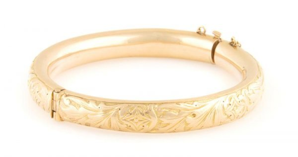 A Yellow Gold Hinged Bangle Bracelet, 19.97 dwts.