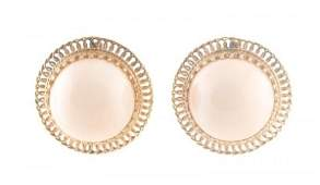 A Pair of 14 Karat Yellow Gold and Angelskin Coral Earr