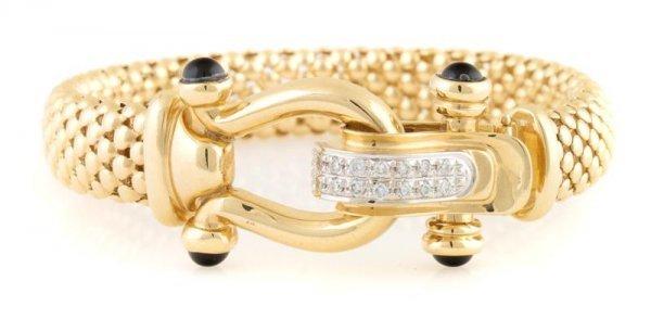 A 14 Karat Yellow Gold, Black Onyx and Diamond Bracelet