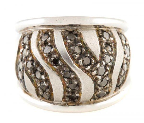 An 18 Karat White Gold and Black Diamond Ring, 9.70 dwt