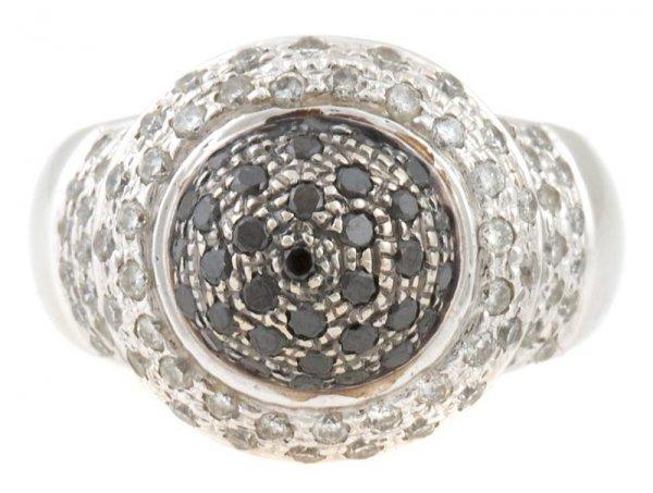 A 14 Karat White Gold, White Diamond and Black Diamond