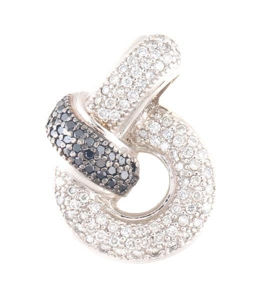 A 14 Karat White Gold, Black Diamond and White Diamond