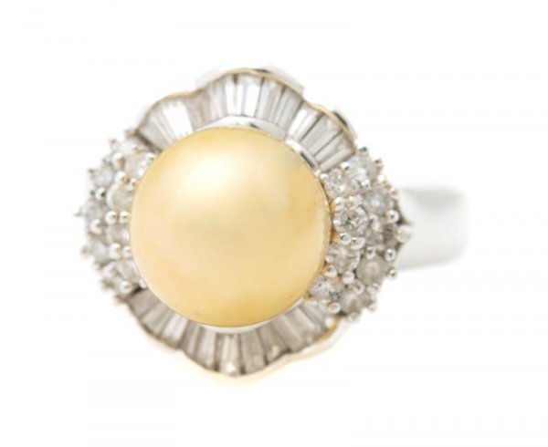 An 18 Karat White Gold, Golden South Sea Cultured Pearl