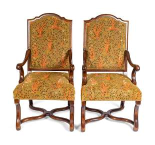 A Pair of Regence Style Walnut Armchairs Height 44 x