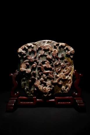 A Carved Jade Bi Disk