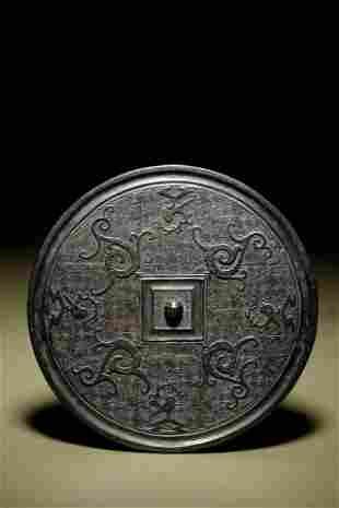 A Bronze Circular 'Phoenix' Mirror