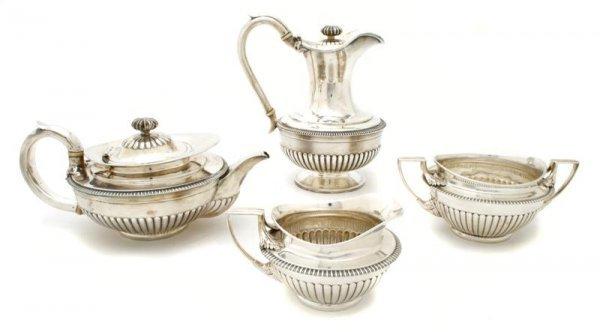 719: An English Silver Partial Coffee and Tea Service,