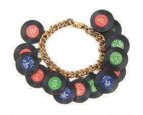 21: An Elvis Presley Plastic Record Charm Bracelet,
