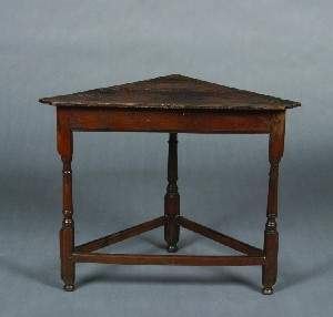 An Oak Corner Table, Height 26 1/4 x width 32 1/2 x