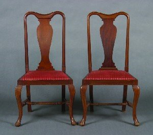 15: A Set of Four Queen Anne Style Walnut Side Chairs,