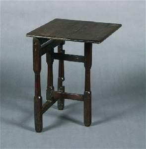 21: An English Oak Gate Leg Coaching Table, Height 23 x