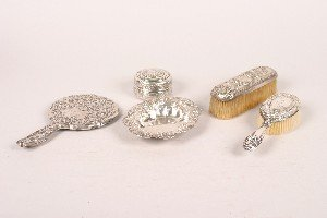 328: A Collection of Silver Dresser Articles,