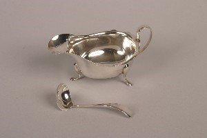 337: A George V Silver Sauce Boat and Ladle,