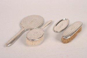343: An American Silver Four Piece Dresser Set,