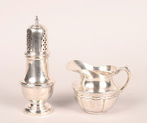 344: A Silver Creamer, Height of castor 7 1/4 inches.