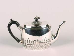 An Edward VII Silver Tea Pot, Hegiht 5 1/4 inches.