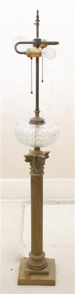 8: A Group of Two Cast Metal Table Lamps, Height of tal