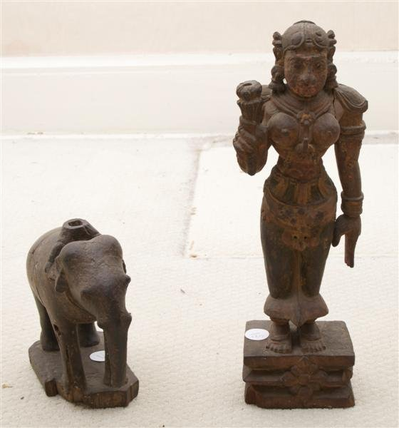 12: A Group of Seven Carved Indian Figural Articles, He