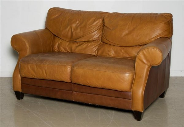 583A: A Leather Settee.