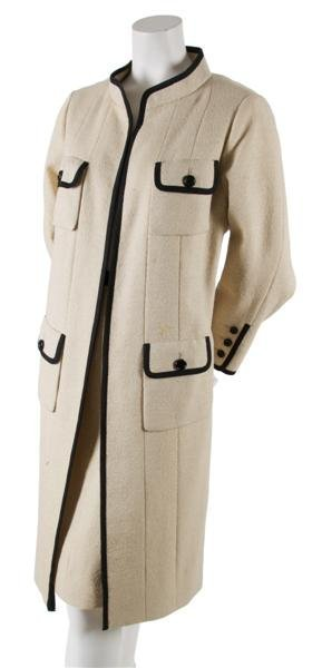 16: A Traina-Norell Cream Wool Coat,
