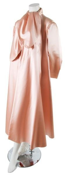 19: A Traina-Norell Pink Satin Evening Coat,