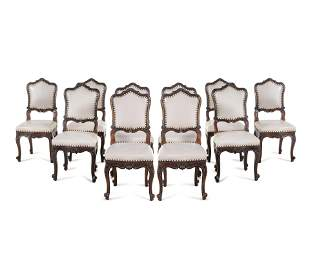 A Set of Ten Louis XV Provincial Oak Dining Chairs
