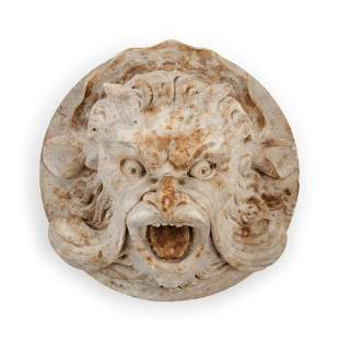 A Continental Carved Stone Grotesque Mask