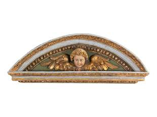 A Baroque Painted and Parcel Gilt Transom Ornament