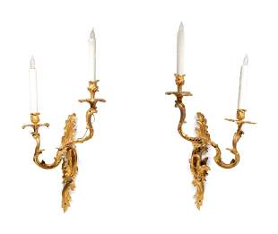 A Pair of Louis XV Style Gilt Bronze Wall Lights with a