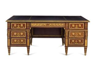 A Louis XV Style Gilt Bronze Mounted Mahogany Desk