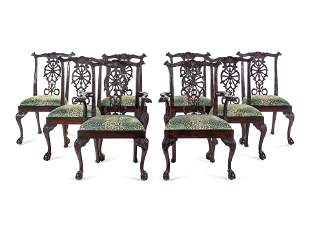 A Set of Eight George III Style Carved Mahogany