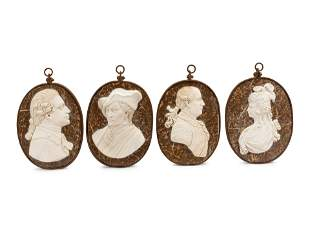 A Set of Four Iron-Framed Carved Marble Portrait