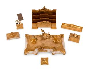 A French Gilt Bronze and Onyx Seven-Piece Desk Set by
